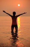 sunrise cheering woman  Stock Images