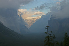 Sunrise in Yosemite Valley. Scenic view of sunrise in Yosemite Valley with cloudscape and mountains in background, California, U.S.A Stock Photos