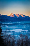 Sunrise in Zakopane with illuminated mountain by sun in winter, Tatra Mountains. Poland Royalty Free Stock Photography
