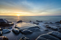 SunriseLake Superior. Rocky shore of Lake Superior during dusk time Royalty Free Stock Photography