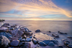 SunriseLake Superior. Rocky shore of Lake Superior during dusk time Stock Photo