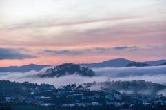 Sunrises, fog and red cloud  somwhere near Dalat city - in Dalat- VietNam. Sunrises somwhere near Dalat city - in Dalat- VietNam- LamDong- VietNam Stock Image