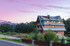 Sunrises over quaint country home beside fence Stock Photos