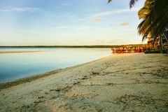 Sunrises over tropical beach. Royalty Free Stock Images