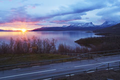 Sunrising over Torne träsk and U-shaped mountain named Lapporten Stock Photos