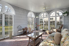 Sunroom with back yard views. Sunroom in luxury home with view to back yard Royalty Free Stock Photos