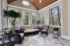 Sunroom in luxury home. With circular window stock photography