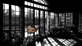 Sunroom. Of a mansion in black and white with the original shot in color on the easel stock images