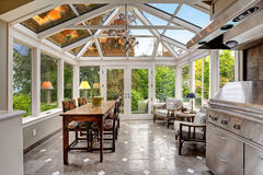 Sunroom patio area with transparent vaulted ceiling Royalty Free Stock Photos