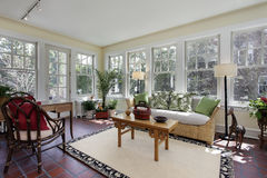 Sunroom with red brick flooring. Sunroom in suburban home with red brick flooring royalty free stock photo