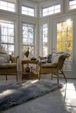 Sunroom in shades of Pale. A cheerful sunroom offers a cozy retreat during the cooler days of autumn in Canada royalty free stock photo