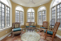 Sunroom with terra cotta floors. Sunroom in luxury home with terra cotta floors royalty free stock images