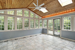 Sunroom with wall of windows stock photos
