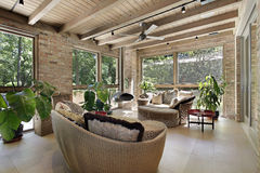 Sunroom with wicker furniture. Sunroom in luxury home with wicker furniture royalty free stock photo