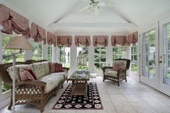 Sunroom with wicker furniture. Sunroom in modern home with wicker furniture Stock Photos