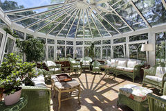 Sunroom with wicker furniture. Sun room with wicker furniture stock photo