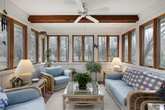 Sunroom with wood ceiling beam. And wicker furniture stock photo