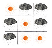 Suns and black clouds. Tic-tac-toe Noughts and Crosses game with sun and black clouds instead of  Xs and Os Stock Photography