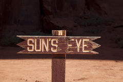 Suns Eye Sign. An old wooden suns eye sign Stock Photography