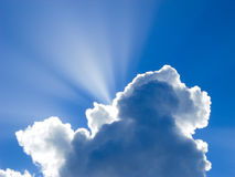 Suns rays behind Clouds. Sun rays shine from Behind Storm Clouds Stock Photography