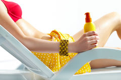 Sunscreen. Close-up of a girl�s hand holding sunscreen Royalty Free Stock Images