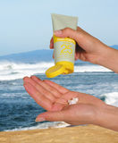 Sunscreen. Woman applying sunscreen Royalty Free Stock Photography
