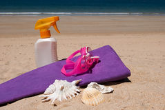 Sunscreen and beach towel Royalty Free Stock Photography