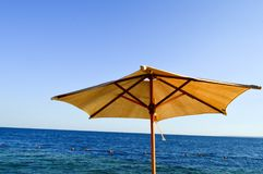 Beautiful natural unique umbrellas made of yellow fabric from dried branches against the blue sky, salt sea at the paradise tropic stock image