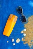 Sunscreen bottle on blue towel royalty free stock photo
