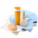 Sunscreen cream and bath towel Royalty Free Stock Photography