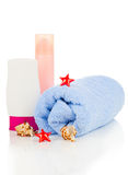 Sunscreen cream and bath towel Stock Photos
