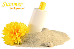 Sunscreen and flower on sand. Isolated on white background.Summer concept Stock Photography