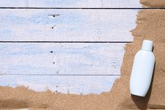 Sunscreen. Jar of sunscreen on the beach sand Royalty Free Stock Images