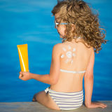 Sunscreen lotion drawing sun Stock Image