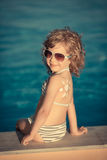 Sunscreen lotion drawing sun Stock Photography