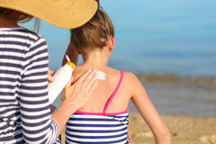 Sunscreen. Mother applying sunscreen to her daughter Stock Images
