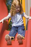 Sunscreen Please. Small red haired child playing on slide. Needs sun screen royalty free stock photography