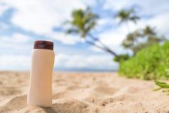 Sunscreen sun lotion bottle on beach vacation Stock Photos