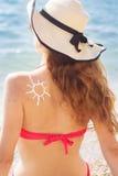 Sunscreen tan lotion sun drawing on woman back Stock Photography