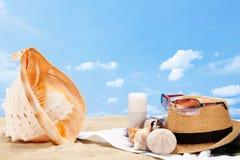 Sunscreens and shells Royalty Free Stock Photo