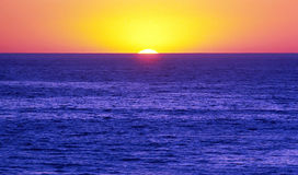 SUNSET 1. Sunset by Pacific Ocean with sun setting behind horizon Stock Image