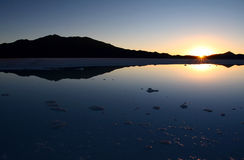 Sunset. Sun setting on a saltlake in Bolivia stock image