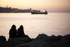Sunset. Couple in front a sunset to Valparaiso, Chile Royalty Free Stock Images