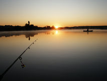 At sunset. Fishing on the lake at sunset Stock Photo