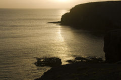 Sunset. At the coast, calm ocean Stock Images