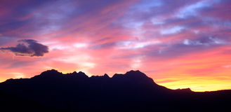 Sunset. Evening sky with the silhouette of a  mountain range Royalty Free Stock Image