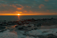 Sunset. On winter gulf of Finland Stock Photography