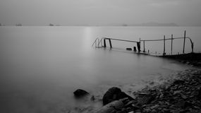 Sunset. With a wooden bridge with long exposure in Black and White version Stock Photography