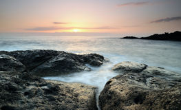 Sunset. On tenerife  at a lava beach Royalty Free Stock Images