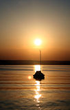 Sunset. Boat on the sunset lake Royalty Free Stock Photos